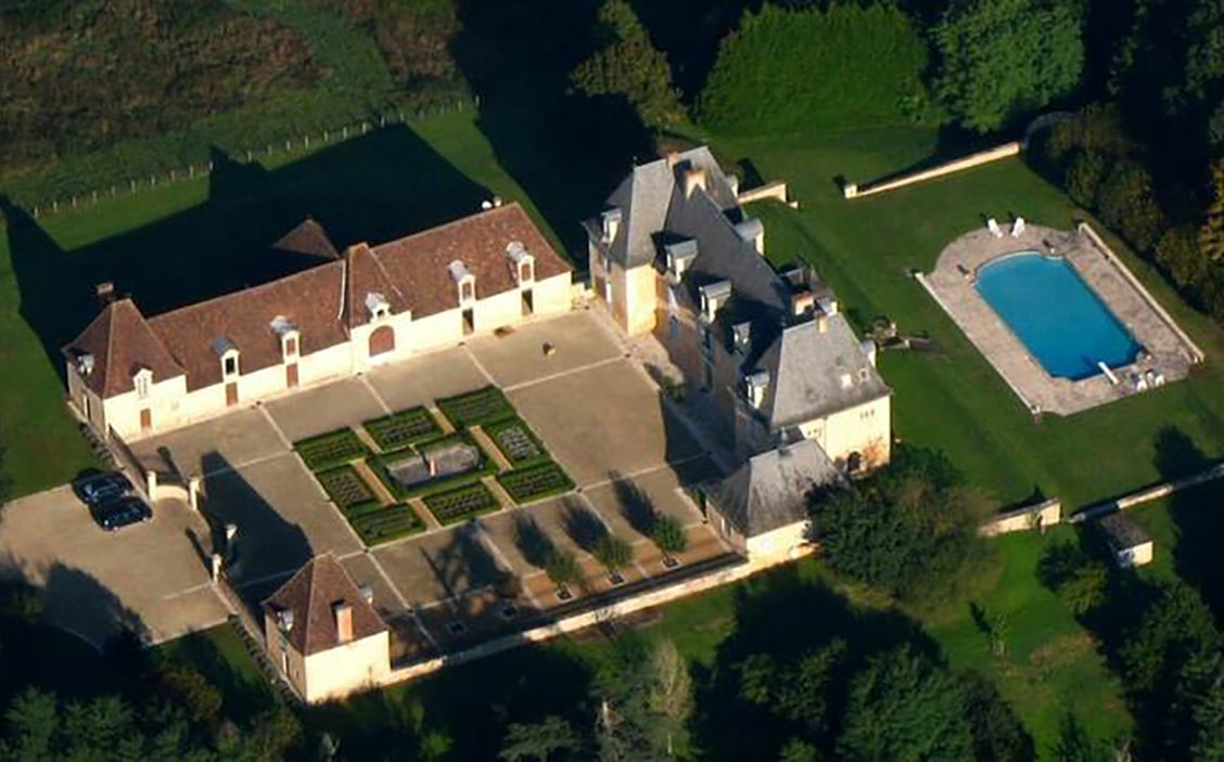 french chateau with gardens and pool