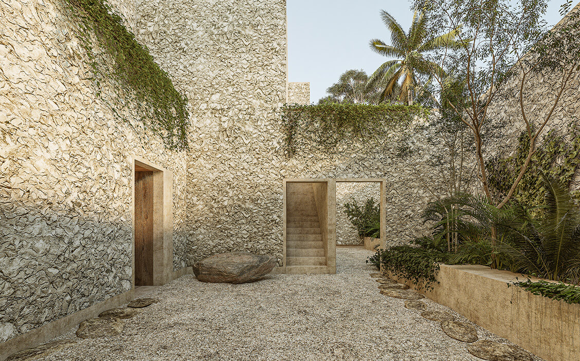 courtyard with greenery on stone walls